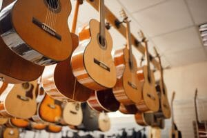 row of acoustic guitars