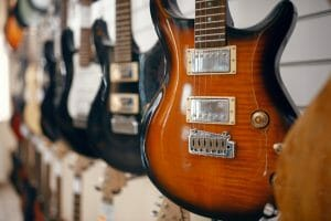 Rows of electric guitars in music store. Friendly Frets, Everett WA 98208. Electric guitar buying guide for beginners.